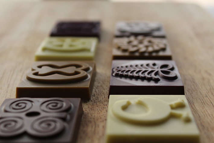 57 Chocolate Adinkra Bars Feature Shoko Press