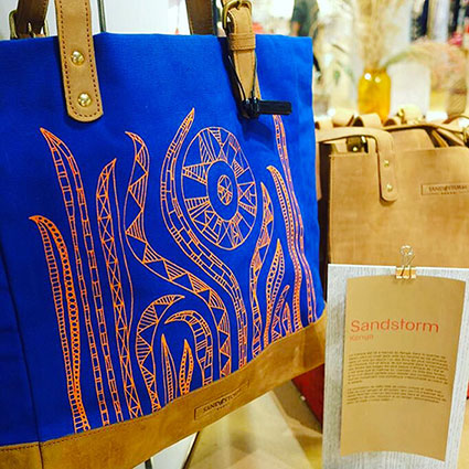 Kenyan Design Graphic Designer and Illustrator Lulu Kitololo Collaborates with Sandstorm Kenya to Create the Sun Worshipper Bag